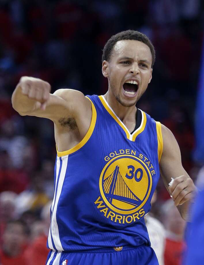 Stephen Curry, who hitting the tying three-pointer in the final seconds of regulation and scored 40 points, celebrates the Warriors' 123-119 overtime victory. Photo: Gerald Herbert, Associated Press