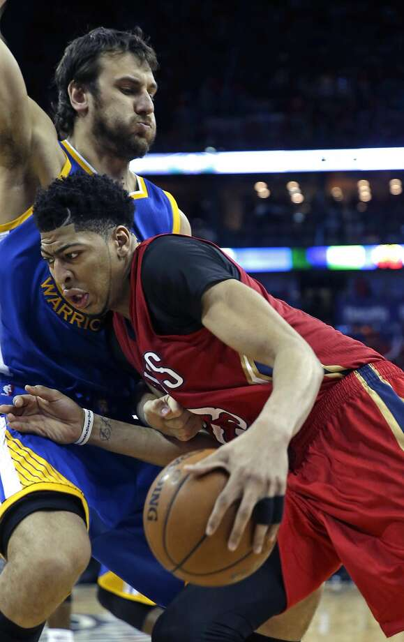 New Orleans Pelicans forward Anthony Davis (23) drives to the basket against Golden State Warriors center Andrew Bogut (12) during the second half of Game 3 of a first-round NBA basketball playoff series in New Orleans, Thursday, April 23, 2015. The Warriors won in overtime 123-119, to take a 3-0 lead in the best-of-seven series. (AP Photo/Gerald Herbert) Photo: Gerald Herbert, Associated Press