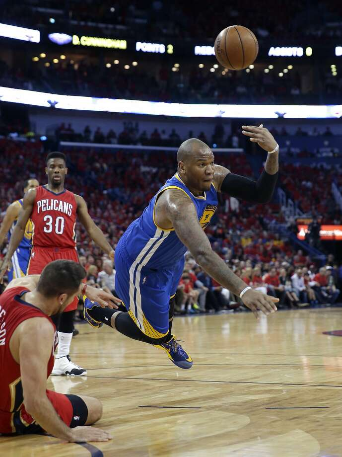 Golden State Warriors' Marreese Speights tries to dish off the ball as he falls to the court with New Orleans Pelicans forward Ryan Anderson, lower left, during the first half of Game 3 of a first-round NBA basketball playoff series in New Orleans, Thursday, April 23, 2015. (AP Photo/Gerald Herbert) Photo: Gerald Herbert, Associated Press