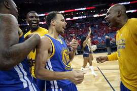 Golden State Warriors guard Stephen Curry, center , celebrates with guard Leandro Barbosa, right, and center Festus Ezeli, left, after their overtime victor over the New Orleans Pelicans in  Game 3 of a first-round NBA basketball playoff series in New Orleans, Thursday, April 23, 2015. The Warriors won in overtime 123-119, to take a 3-0 lead in the best-of-seven series. (AP Photo/Gerald Herbert)