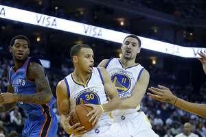 Golden State Warriors' Stephen Curry and Klay Thompson during 117-91 win over the Oklahoma City Thunder in NBA game at Oracle Arena in Oakland, Calif. on Monday, January 5, 2015.