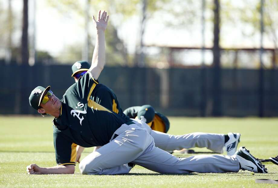 The A's Chris Bassitt, shown stretching during spring training in Mesa, Ariz., was called up on Thursday. Photo: Scott Strazzante, The Chronicle