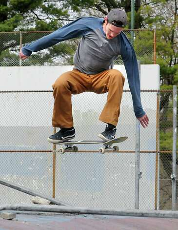 Garrett Rowland of Albany flies through the air on his skateboard in Washington Park on Thursday, April 23, 2015 in Albany, N.Y. (Lori Van Buren / Times Union) Photo: Lori Van Buren