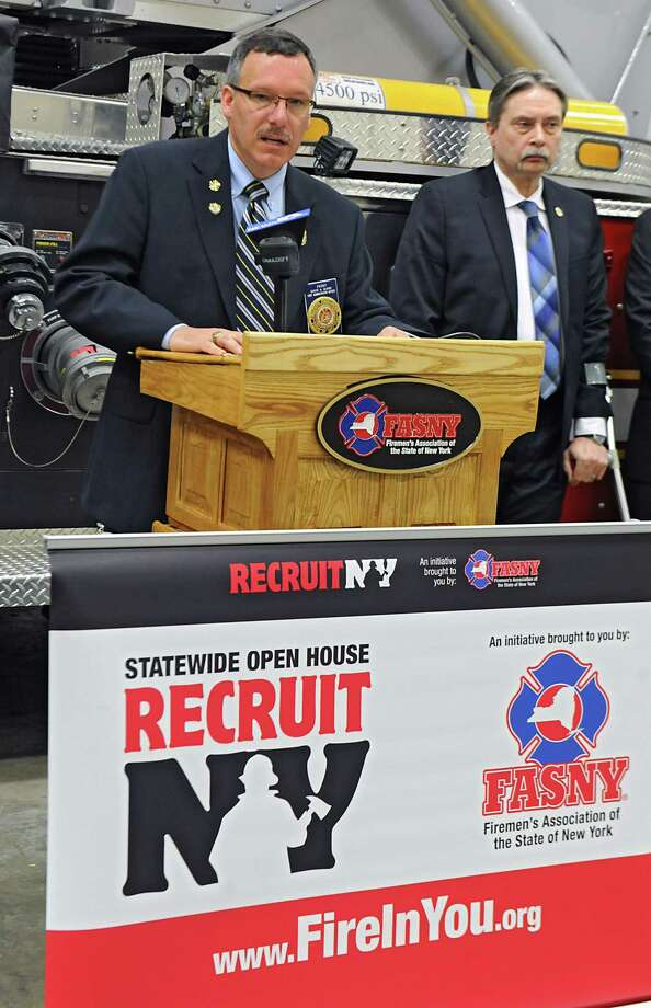 Firemen's Association of the State of New York State Chief Administrative Officer David Quinn speaks during the RecruitNY weekend press conference at the Halfmoon Fire Department on Thursday, April 23, 2015 in Waterford, N.Y. Fire Administrator Bryant Stevens, right, also spoke. The event at volunteer fire departments across the state will open their doors to their community to educate the public about what it takes to become a volunteer firefighter in a grassroots effort to boost membership. (Lori Van Buren / Times Union) Photo: Lori Van Buren / 00031570A