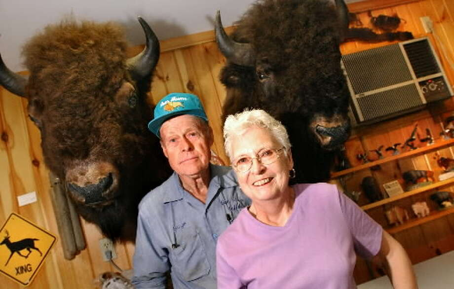 This file photograph shows George, left, and Gerry Mesick pose among the items for sale in their Trading Post on Thursday, June 10, 2004, at Gem Farms in Schodack, N.Y. The Mesicks raise and sell bison meat. Mesick said he fears buffalo that escaped from his farm on Thursday might be the animals police are trying to find in Bethlehem. (Cindy Schultz / Times Union)