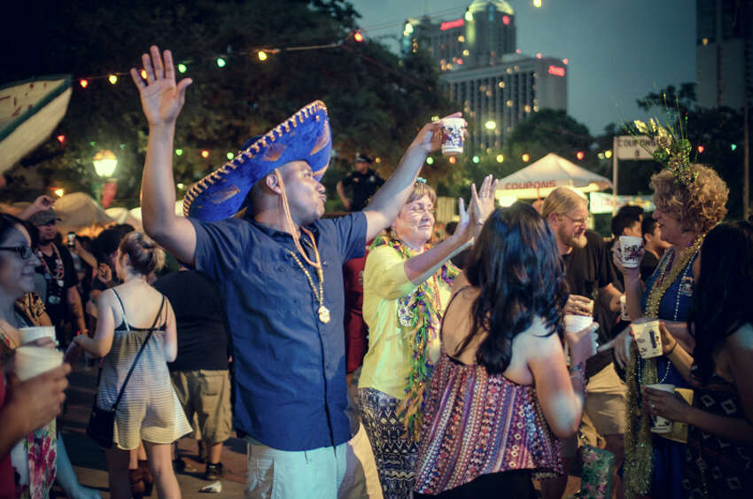 Residents were seen at Night in Old San Antonio, the largest non-parade event during Fiesta, Thursday night, April 24, 2015.