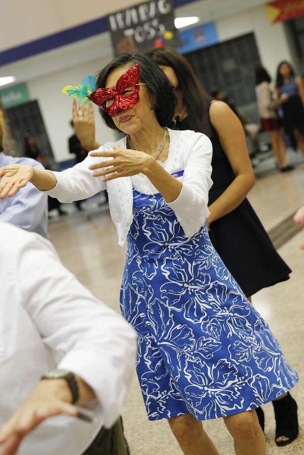 Poyee Tam dances the Macarena at the Senior Citizens Masquerade Ball. Photo: Diana L. Porter / © Diana L. Porter