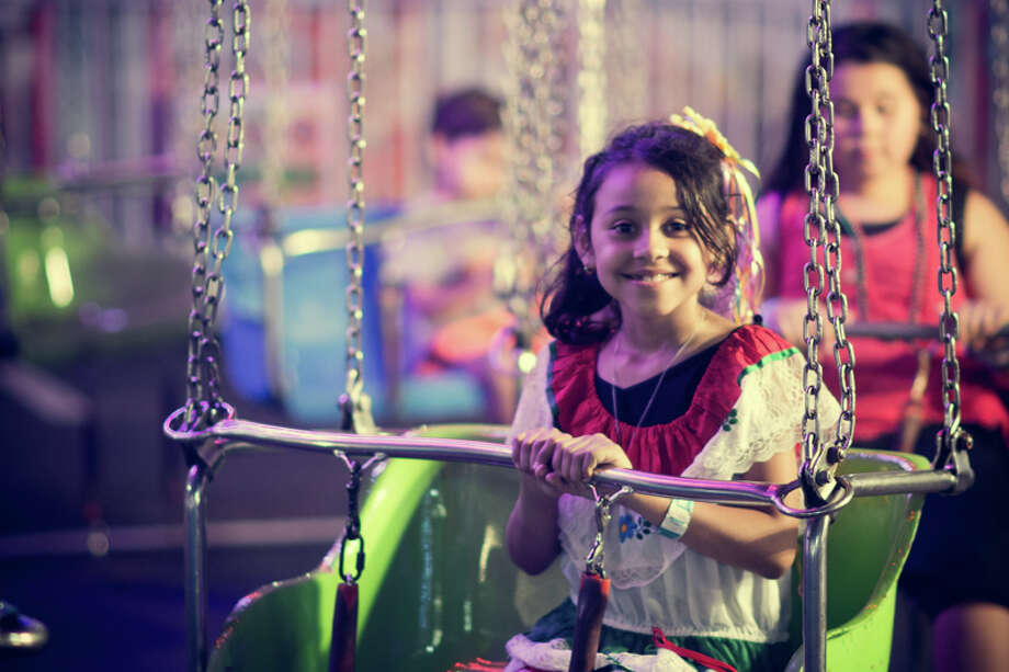 Thousands of San Antonio families enjoyed live music, a wide assortment of food and rides at the Alamodome for Fiesta Carnival Thursday night. Photo: Chavis Barron / For The Express-news