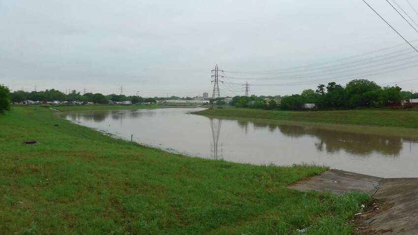 Friday morning's rain filled the Olmos Creek with more water than average at the San Pedro Avenue bridge.