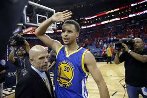Golden State Warriors guard Stephen Curry (30) reacts after their overtime victory in Game 3 of a first-round NBA basketball playoff series against the New Orleans Pelicans in New Orleans, Thursday, April 23, 2015. The Warriors won in overtime 123-119, to take a 3-0 lead in the best-of-seven series. (AP Photo/Gerald Herbert)