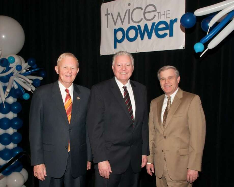 Richard Smith and Steve Barnes stand by their new partner, Bruce Zipf, president and chief executive officer of NRT LLC.
