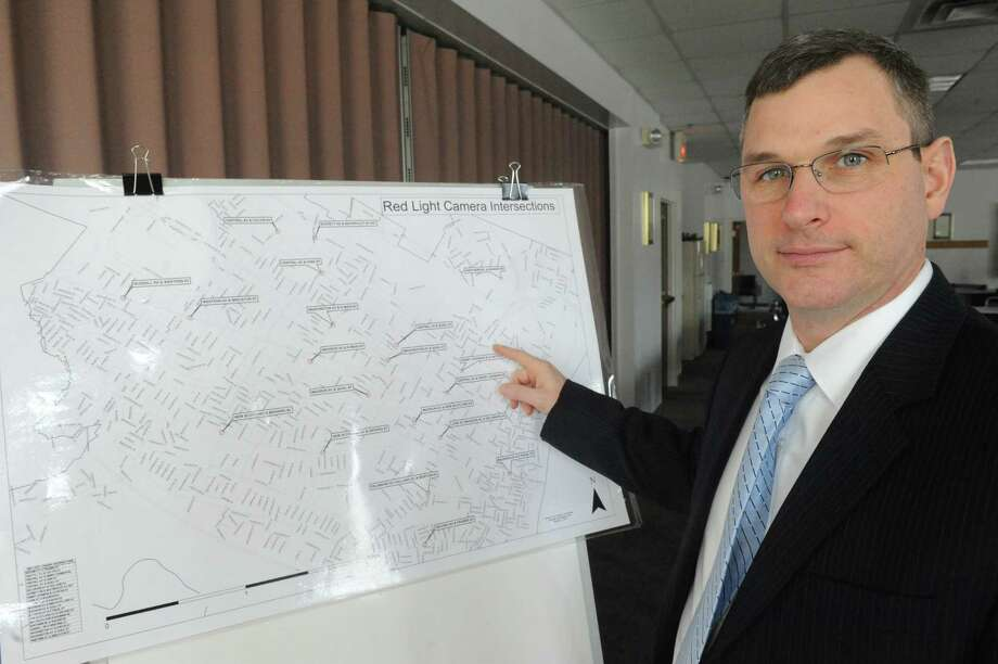 Albany Police Assistant Chief Brendan Cox points to a map of the 20 intersections that red light cameras will be installed on Friday Feb. 6, 2015 in Albany , N.Y.  (Michael P. Farrell/Times Union) ORG XMIT: MER2015020615270788 Photo: Michael P. Farrell / 00030511A