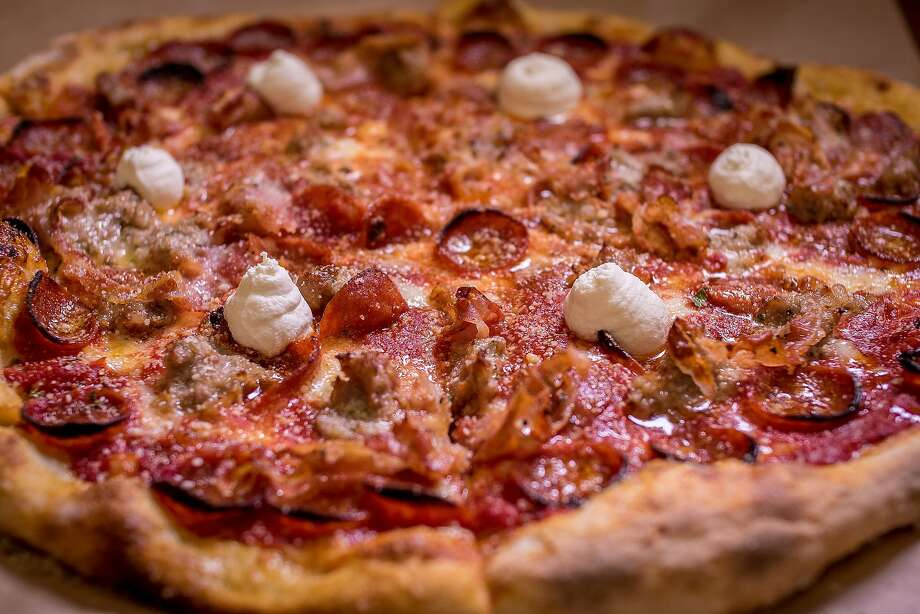 The New Yorker pizza is just one of the choices at Jersey, which has an open kitchen in back built around the pizza ovens. Photo: John Storey, Special To The Chronicle