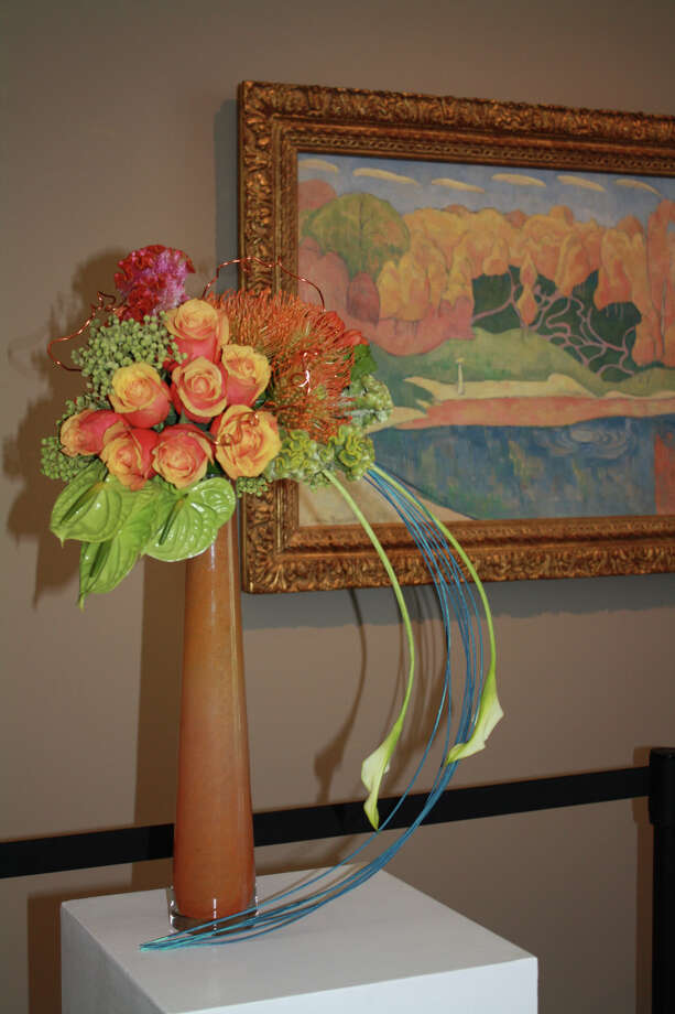 """Floral designs inspired by masterpieces are one highlight of """"Florescence: Illusions"""" at the Museum of Fine Arts, Houston. Horticultural specimens, conservation exhibits, botanical jewelry and photography also are part of this major flower show."""