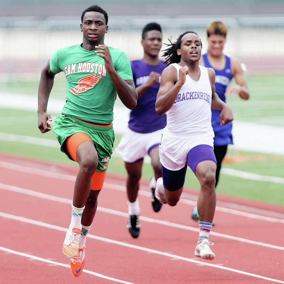 Sam Houston's Jonathan Challenger (left) races Brackenridge's Robert Allen to the finish line of the 200-yard dash during the District 27-5A/28-5A area high school track and field meet at Rutledge Stadium on Thursday, April 23, 2015. Challenger won the event with a time of 22.34 seconds.  Allen was second at 22.68 seconds.  MARVIN PFEIFFER/ mpfeiffer@express-news.net Photo: Marvin Pfeiffer, Staff / San Antonio Express-News / Express-News 2015