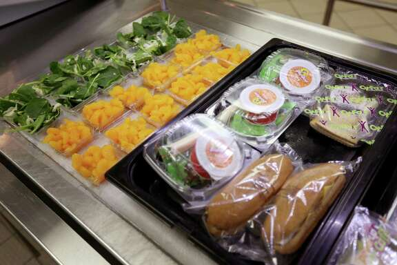 Fruit, salads, sandwiches, shown, along with hot dogs, pizza are options for lunch at Holbrook Elementary School Friday, Feb. 20, 2015, in Houston, Texas.