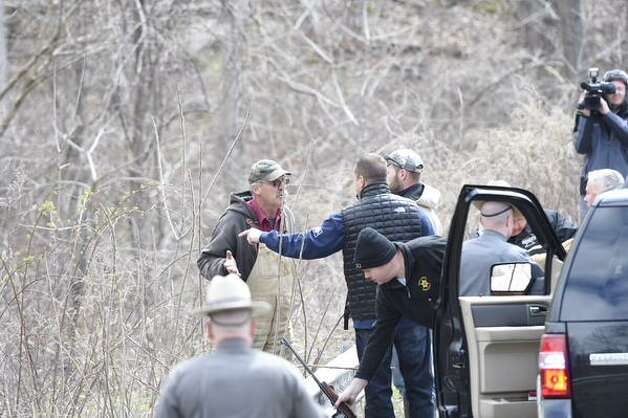 Albany County Sheriff Craig Apple has a heated exchange with one of the hunters who was brought in to shoot a herd of buffalo that were on the loose in Bethlehem. The man was taken into custody after a heated exchange with the sheriff. Moments later, Apple and an investigator  took the man into custody. (Skip Dickstein / Times Union)