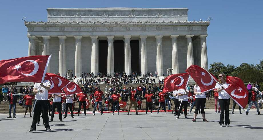 Youths wave Turkey's flag at the Lincoln Memorial at an event to improve Turkish-Armenian relations. Photo: Nicholas Kamm, AFP / Getty Images