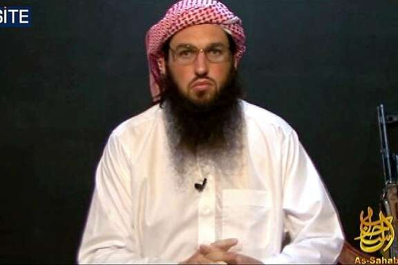 "(FILES) This October 23, 2010 file still image released by the Site Intelligence Group  shows Al-Qaeda's American spokesman Adam Gadahn delivering a video message, produced by Al-Qaeda's media arm As-Sahab. Adam Gadahn, the Al-Qaeda spokesman believed killed in a US operation, was a teenage rock music fan who grew up on a Californian goat farm before he was drawn into radical Islam.  The White House announced April 23, 2015 that US intelligence thinks Gadahn died in January in a ""counterterrorism operation"" in the Afghanistan-Pakistan border region. The 36-year-old was apparently not deliberately targeted in the raid, but he has long been one of the most wanted jihadist figures on the US hit list, with a $1 million bounty on his head."