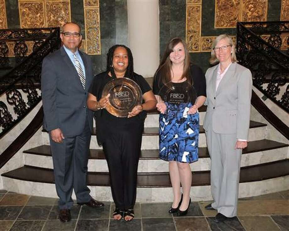 Fort Bend Independent School District announced its teachers of the year at the annual awards dinner on April 23. From left are Charles Dupre, district superintendent; Melanie Hines, 2015 FBISD Elementary Teacher of the Year; Stacy Vinson, 2015 FBISD Secondary Teacher of the Year; and Grayle James, FBISD board president. Photo: Fort Bend ISD