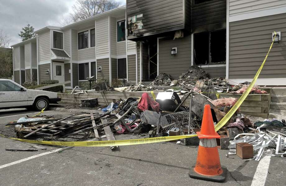 The scene the day after a fire at Casagmo condominiums in Ridgefield, Friday, April 24, 2015. Photo: H John Voorhees III / The News-Times
