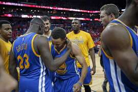 Golden State Warriors guard Stephen Curry (30) celebrates with forward Draymond Green (23) after their overtime victory in Game 3 of a first-round NBA basketball playoff series against the New Orleans Pelicans in New Orleans, Thursday, April 23, 2015.