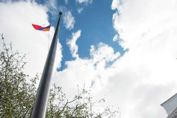 A ceremony was held outside Greenwich Town Hall this morning to commemorate the 100th anniversary of the Armenian genocide. At the end of the ceremony first selectman Peter Tesei and Sylvia Kruizenga raised an Armenian flag on the flag pole in front of the Town Hall, Greenwich, CT on Friday, April 24th, 2015.