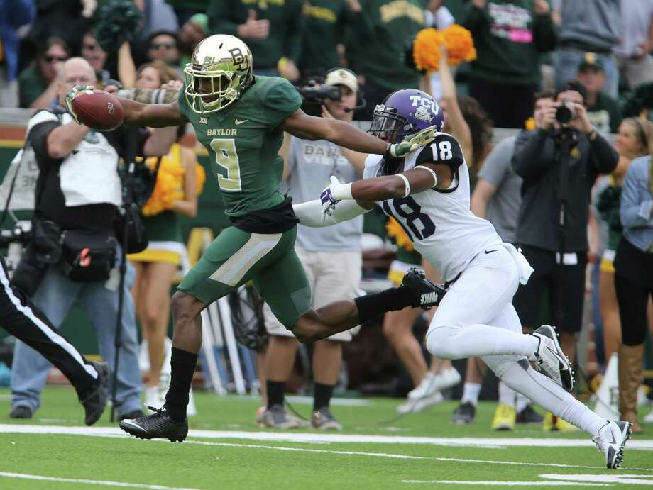 Baylor wide receiver KD Cannon races past TCU cornerback Corry Meally for a touchdown in the first half on Oct. 11, 2014, in Waco. Photo: Jerry Larson /Waco Tribune-Herald / Waco Tribune Herald