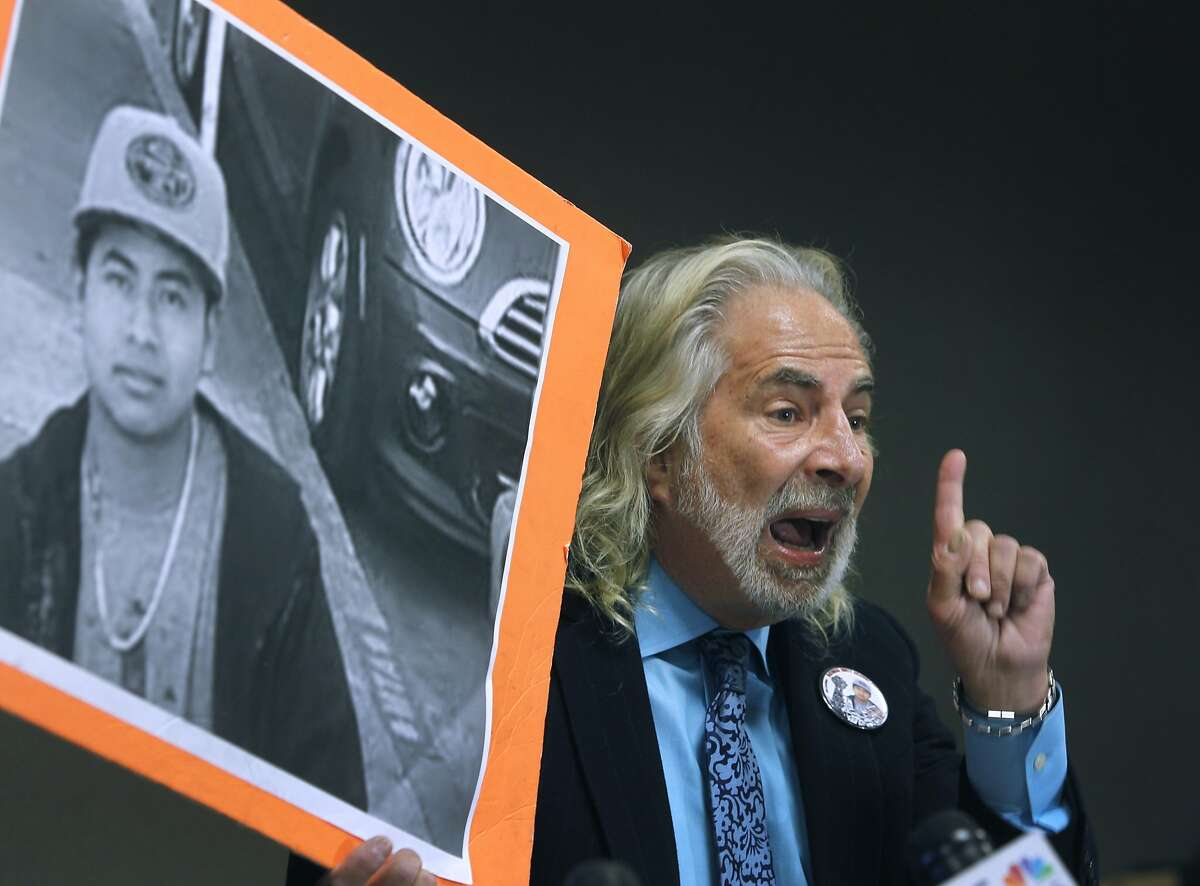 Attorney Jonathan Melrod holds up a photo of Amilcar Perez Lopez at a new conference in San Francisco, Calif. on Friday, April 24, 2015 to announce a federal lawsuit filed against the police department and Chief Greg Suhr. Attorneys allege that police officers killed Lopez on Feb. 26 while he was running from police, disputing the department's version that Lopez had lunged at officers with a knife.