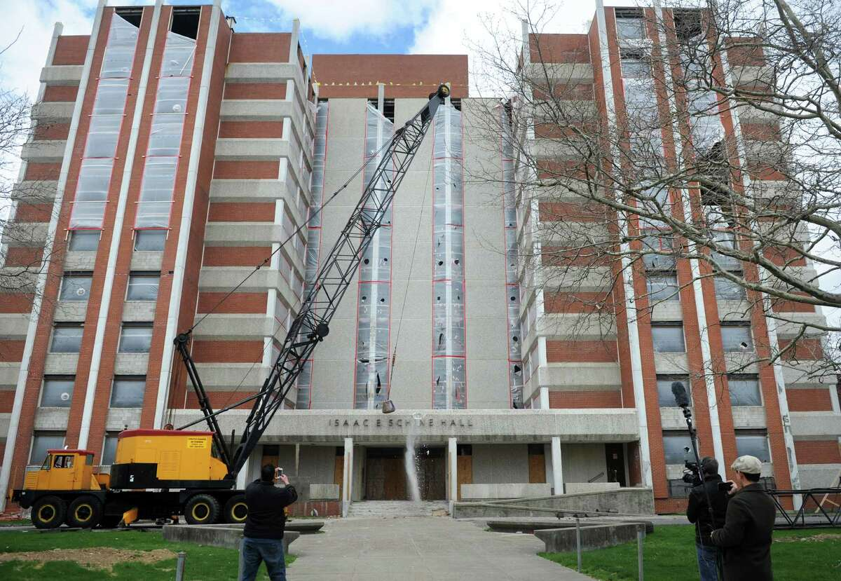 Demolition begins Friday, April 24, 2015, at Isaac E. Schine Hall, a 10-story University of Bridgeport residence building that first opened in 1971. A new dorm, the first on campus in 40 years, will go up across the street.
