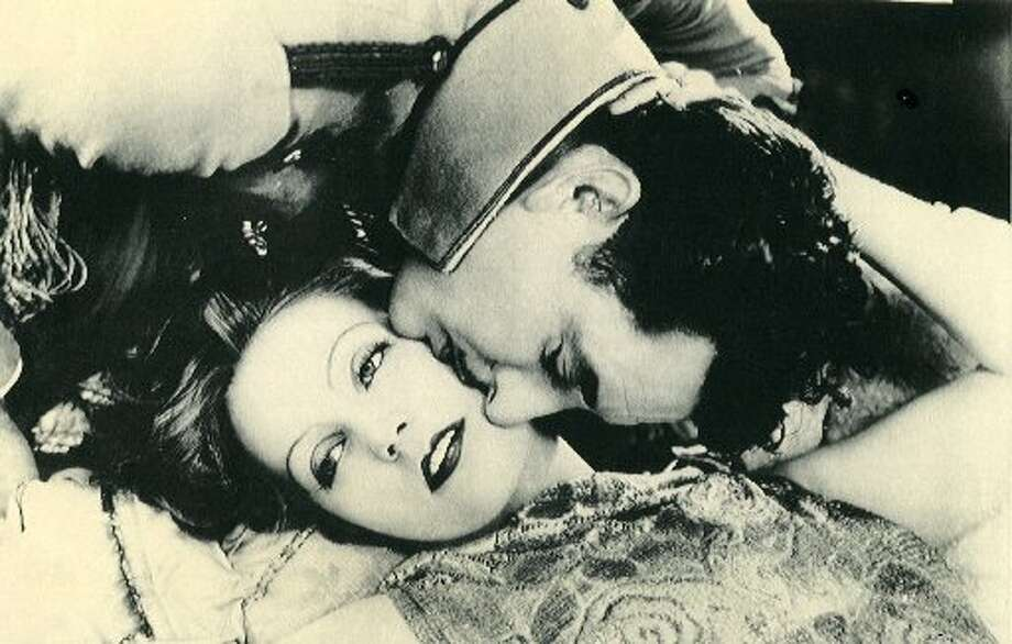 "Greta Garbo and John Gilbert in 1927 movie, ""The Flesh and the Devil"""