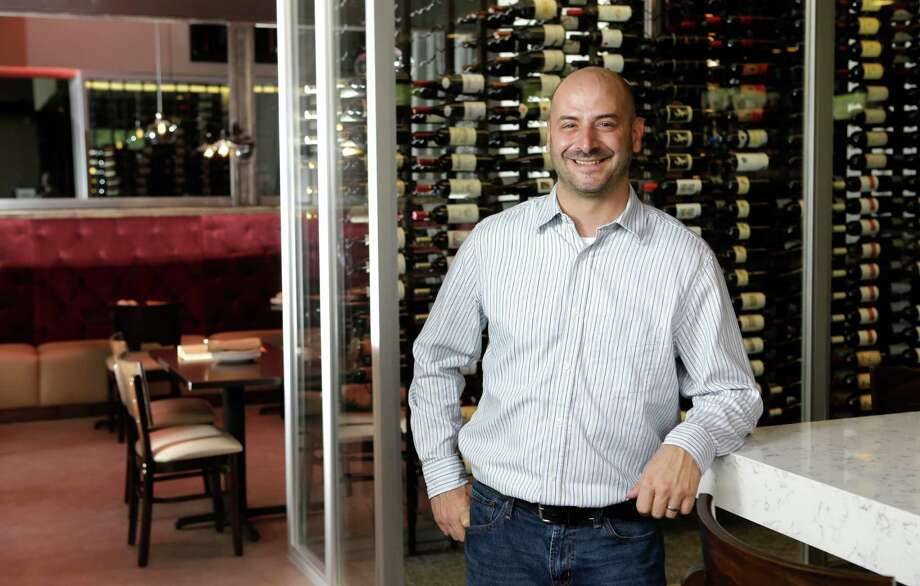 Dave Dobbins, general manager at Crisp in The Woodlands, says the restaurant is known for being chef-driven. Photo: Melissa Phillip, Staff / © 2015  Houston Chronicle