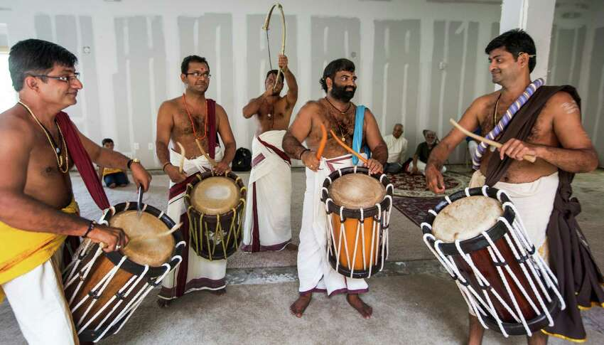 Drummers perform for the installation of the deities ritual at the new Sri Guruvayurappan temple on Thursday, April 23, 2015, in Houston.