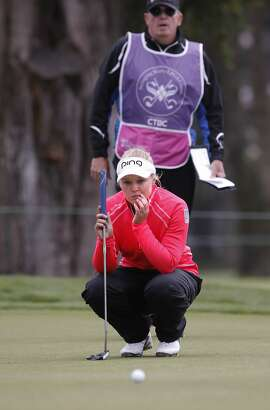 Brooke Henderson looks over her birdie putt on the 1st hole, during second round action at the Swinging Skirts LPGA Classic golf tournament at Lake Merced Golf Course in San Francisco, Calif., on Fri. April 24, 2015.