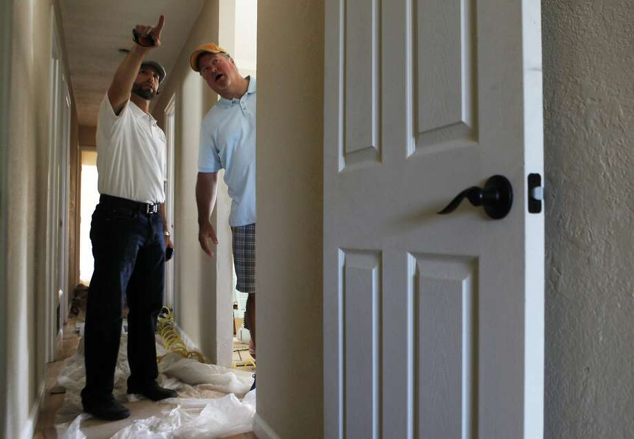Jon Condrey (right)  walks through a former hoarder's home he fixed up and purchased through LendingHome's online marketplace for property investors with LendingHome officer Gabe Bodner in San Jose, Calif. Friday, April 24, 2015. Photo: Jessica Christian, The Chronicle