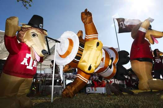An inflatable Bevo, the Longhorns mascot, is roasted on a spit by Reveille, the Aggies mascot, on a display set up by Scott Emmons of Cedar Hill for their Thanksgiving Day tailgate before the start of the Texas A&M Aggies vs University of Texas Longhorns rivalry NCAA football game at Kyle Field on Thursday, November 24, 2011 in College Station, Texas. (Patrick T. Fallon/The Dallas Morning News) Photo: Staff Photographer