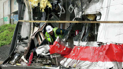 NTSB photo of Elias Kontanis investigating the cause of the May 17, 2013 train derailment in Bridgeport, Conn.