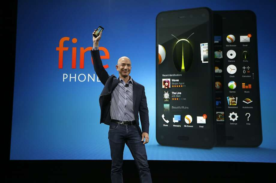 Amazon CEO Jeff Bezos introduces the new Amazon Fire Phone, Wednesday, June 18, 2014, in Seattle. (AP Photo/Ted S. Warren) Photo: Ted S. Warren, Associated Press