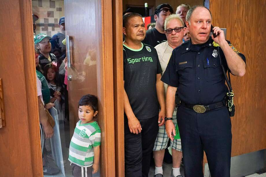 Deputy Fire Marshal Craig Anderson keeps an eye on meeting attendees as they enter Santa Clara City Hall on Tuesday, April 21, 2015 in Santa Clara, Calif. Soccer fans and community members rallied together to speak their mind about the 49ers potentially turning a community soccer field into a parking lot for the Levi's Stadium. Photo: James Tensuan, SFC