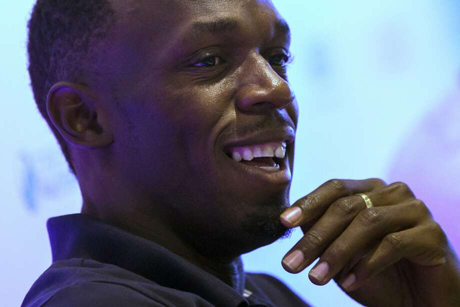 """Jamaican sprinter Usain Bolt smiles during a press conference in Rio de Janeiro, Brazil, Friday, April 17, 2015. Asked to rate himself, Bolt was forthright. He says: """"When I'm in great shape, I'll tell you guys, I worry about nobody because I know that when I'm at my best - it's definitely almost impossible to beat me."""" (AP Photo/Felipe Dana) Photo: Felipe Dana, Associated Press"""