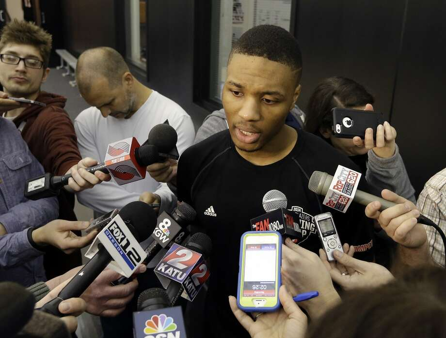 Damian Lillard is 1-for-11 from three-point range in Portland' first two games against Memphis. Photo: Don Ryan, Associated Press