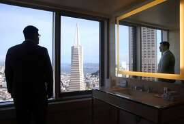 Front office manager Craig Kind admires the view from a guest room's bathroom on the 45th floor of the new Loews Regency Hotel on Sansome Street in San Francisco, Calif. on Friday, April 24, 2015. Loews acquired the old 155 room Mandarin Oriental Hotel and officially took over on April 15.