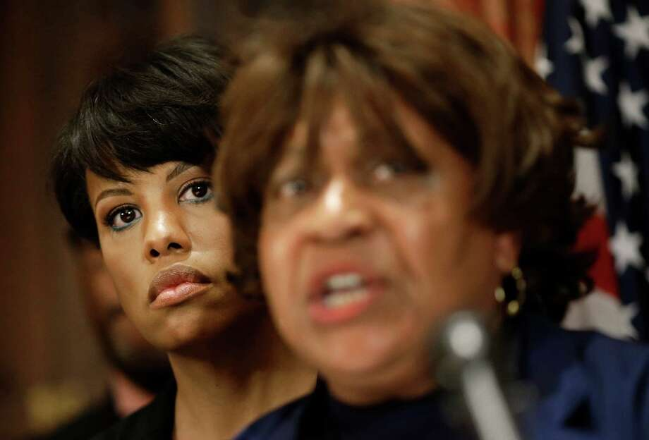 Baltimore Mayor Stephanie Rawlings-Blake listens as the Baltimore NAACP's Tessa Hill-Aston speaks about Freddie Gray's death. Photo: Patrick Semansky /Associated Press / AP