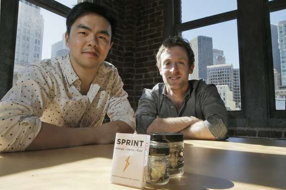 Michael Brandt, right, and Geoff Woo, cofounders of Nootrobox, a San Francisco, Calif., company that produces several nootropics, compounds known as cognitive supplements. They are seen here on Wednesday, March 18, 2015, with their products, Rise, and large quantity supply of their supplements and Sprint, a daily dose which will be available soon.