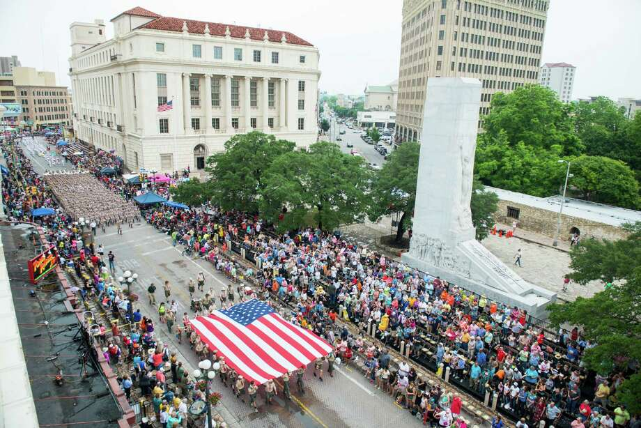 The Boy Scouts of America carry the American Flag during San Antonio Fiesta's Battle of Flowers parade on Friday, April 24, 2015 through downtown San Antonio. Photo: Matthew Busch, For The San Antonio Express-News / For San Antonio Express-News / © Matthew Busch