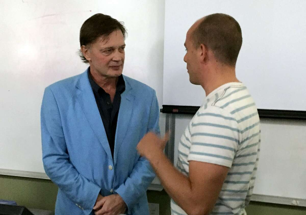 Former physician Andrew Wakefield speaks with students after a lecture at Life Chiropractic College West in Hayward Friday. Wakefield's discredited research linking autism and immunizations helped launch the modern anti-vaccination movement.
