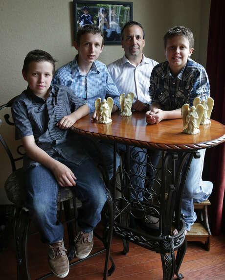"Teddy Voutour relaxes at home with his sons (from left) Skyler, Teddy and Tanner. The family was ""hit by a freight train"" when the boys' mother died in 2012, Voutour said. Photo: Tom Reel /San Antonio Express-News"