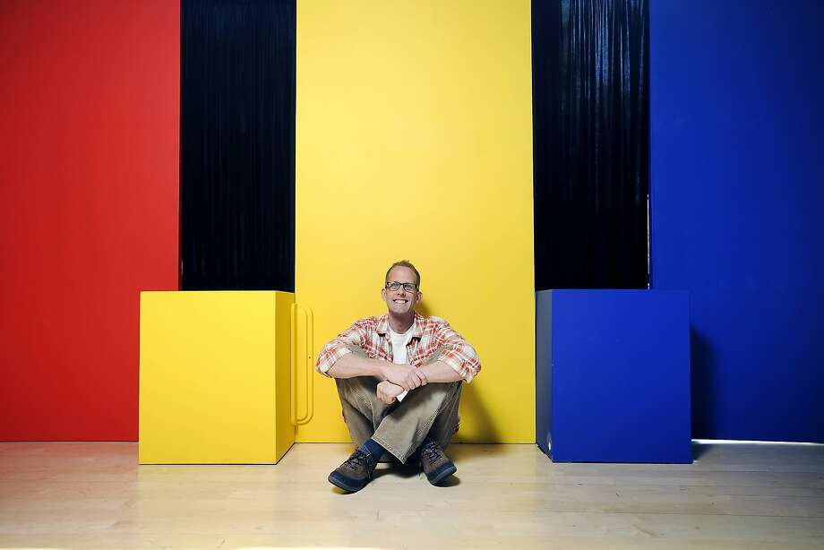 "Academy Award-winning director Pete Docter, who's new animated film ""Inside Out"" is due for release in June, poses for a portrait in front of colored backdrops that represent the films characters, at the Pixar Studios in Emeryville, CA on Friday, April 24, 2015. Photo: Michael Short, Special To The Chronicle"