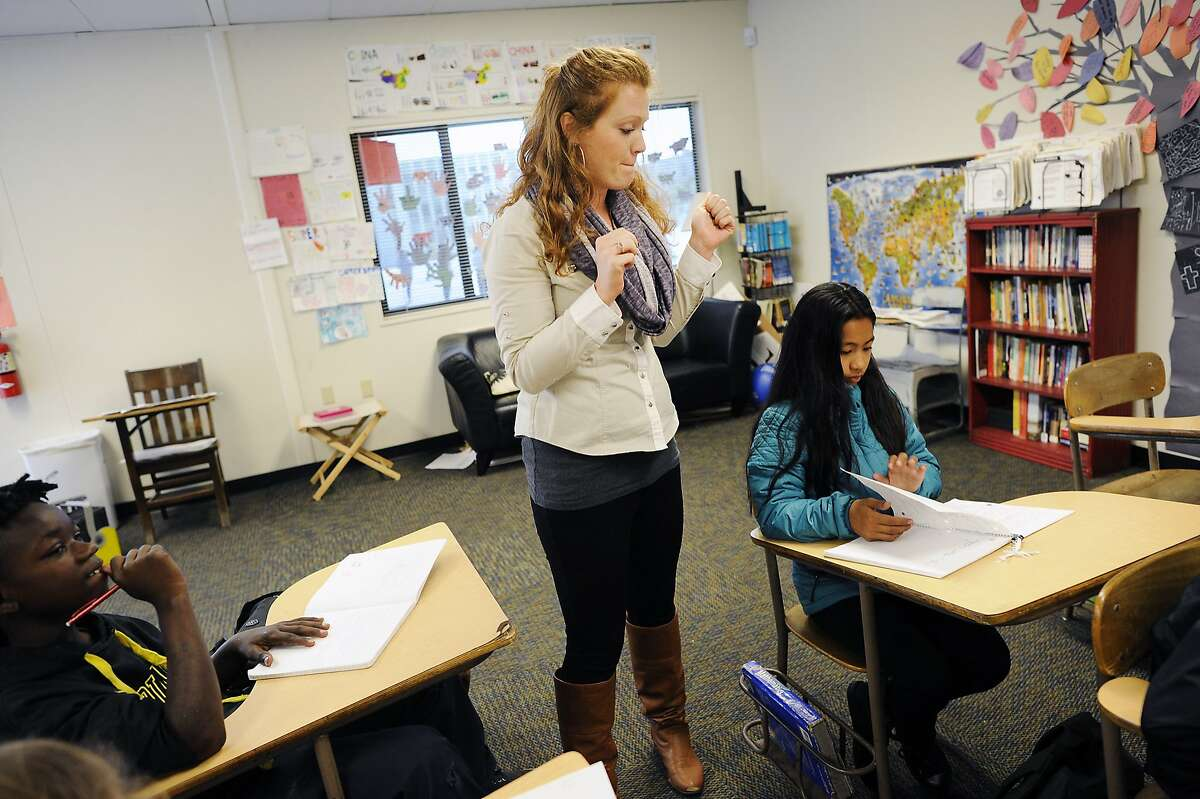 Sixth grade humanities teacher Helana Corda, an eight year veteran of the middle school and former Teach For America participant, guides her students as they prepare for an upcoming computer based portion of the S-BAC test, at James Lick Middle School in San Francisco, CA on Friday, April 24, 2015.