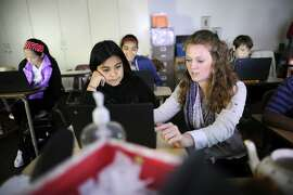 Sixth grade humanities teacher Helana Corda, an eight year veteran of the school and former Teach For America participant, helps student Lesly Vega as the class prepares for an upcoming computer based portion of the S-BAC test, at James Lick Middle School in San Francisco, CA on Friday, April 24, 2015.